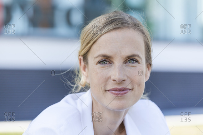 Portrait of smiling blond businesswoman