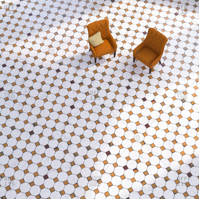 3D rendering- Two chairs on tiled floor