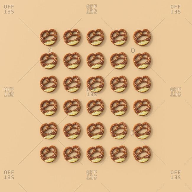 3D rendering- Rows of pretzels on orange background