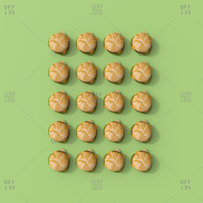 3D rendering- Rows hamburgers of on green background