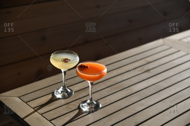 Two cocktails served on outdoor table