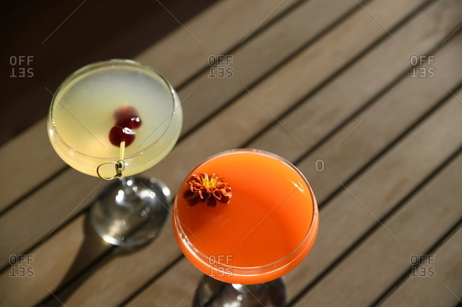 Two mixed drinks served on outdoor table