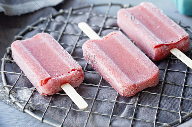 Close up of strawberry popsicles