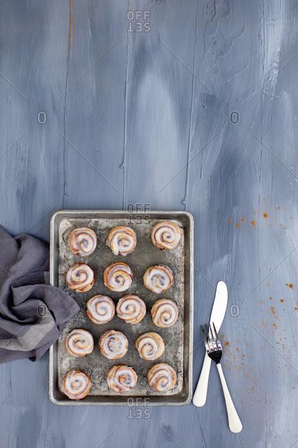 Overhead view of mini cinnamon rolls on a tray