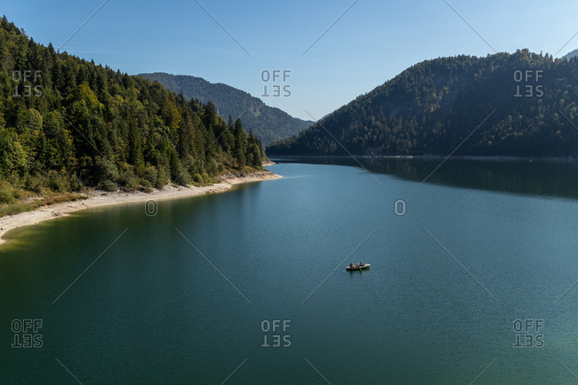 Scenic view of mountain lake with rowboat