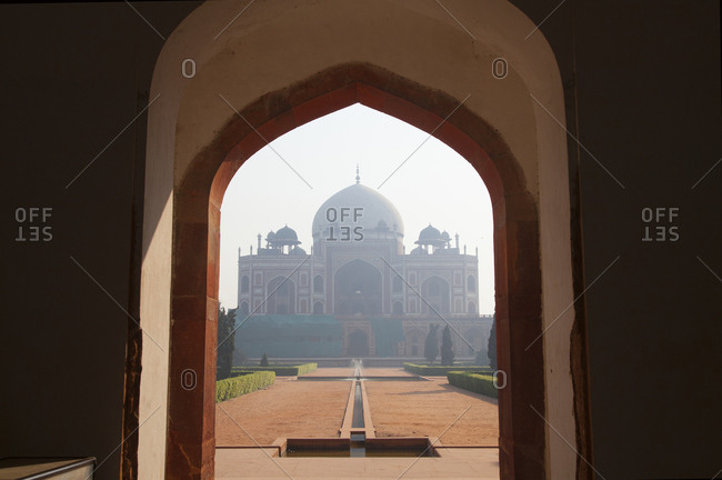 View of Humayun's tomb through archway in Delhi, India