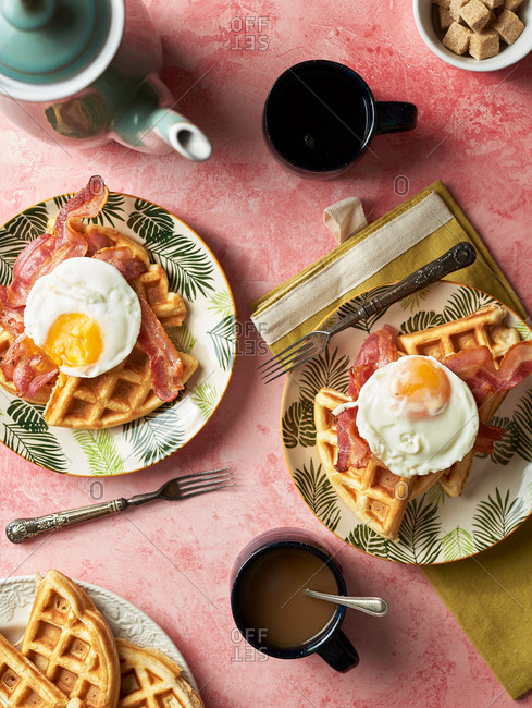 Overhead view of a waffles with bacon and eggs