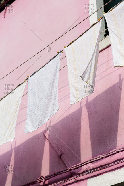 Low angle view of towels drying on a clothesline, Burano, Venice, Italy