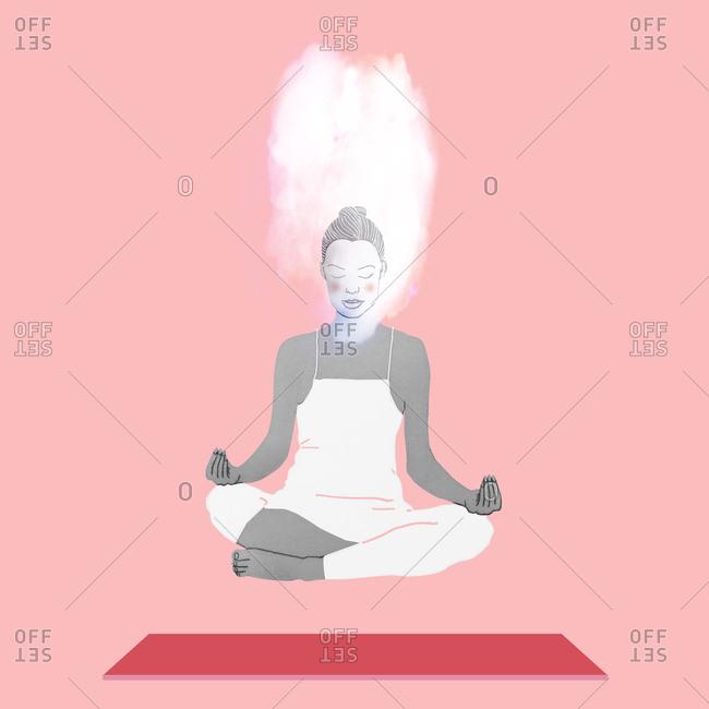 Woman in lotus yoga pose