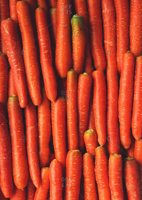 Bright orange carrots arranged in a pattern