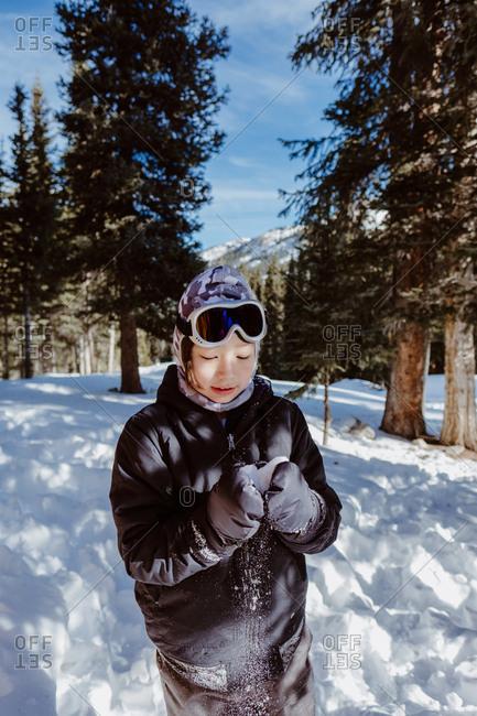 Boy making a snowball