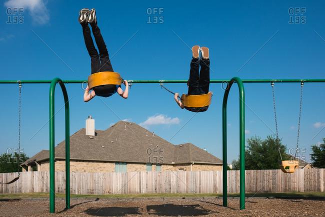 Children swinging at playground