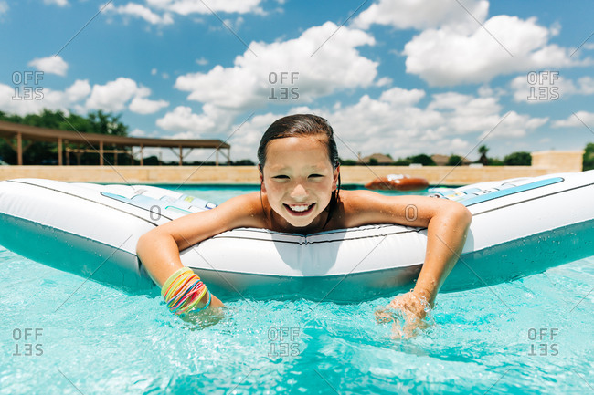 Smiling boy on inflatable pool float