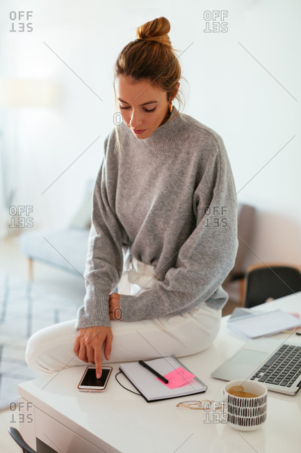 Woman using phone at office