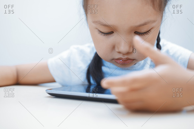 Cute girl using table computer on the table