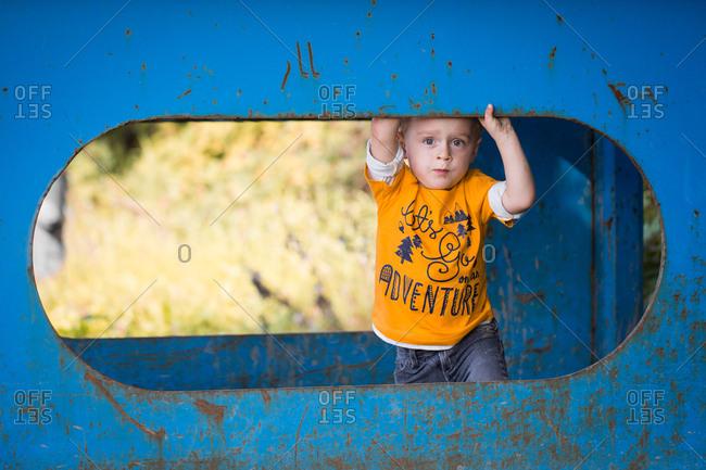Toddler boy exploring structure