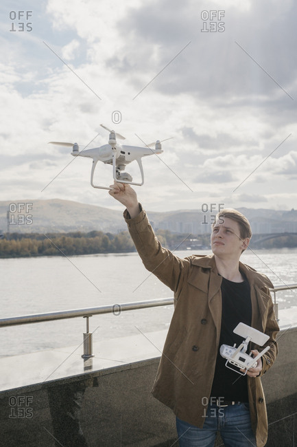 Young man flying a drone