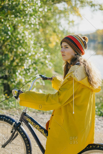 Young woman smiling while riding a bike on a sunny day