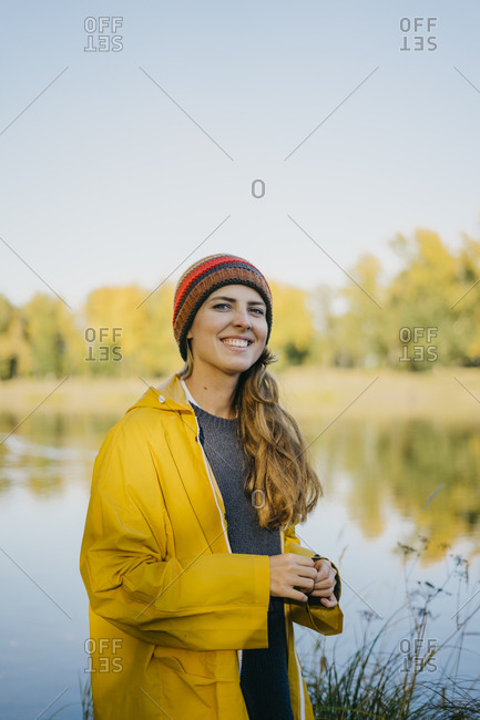 Portrait of a beautiful young girl with the lake in the background