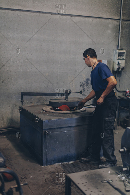 Male worker in a foundry workshop