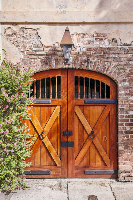 Wooden French doors on old building in Charleston, South Carolina