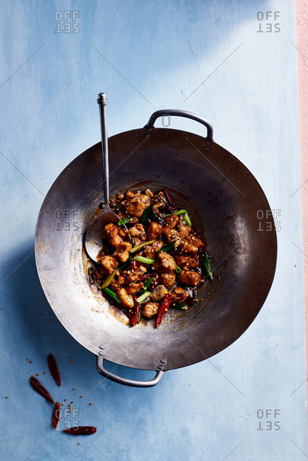 A wok of kung pao catfish