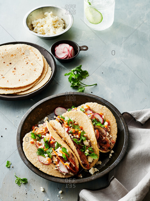 Blackened chicken tacos with tango sauce and fixings