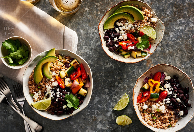 Overhead view of farro burrito bowls spread