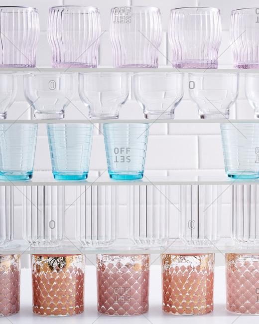 Glasses on glass shelves