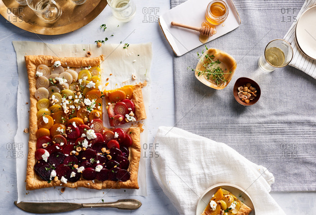 Tricolored beet tart missing a slice