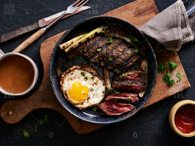 Overhead view of chimi rubbed steak and eggs