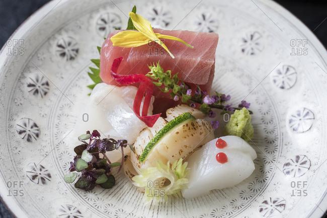 Plate of freshly prepared Japanese sashimi