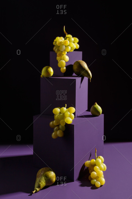 Pears and grapes on purple cubes