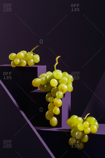 Grapes on purple cubes