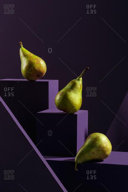 Pears on purple cubes