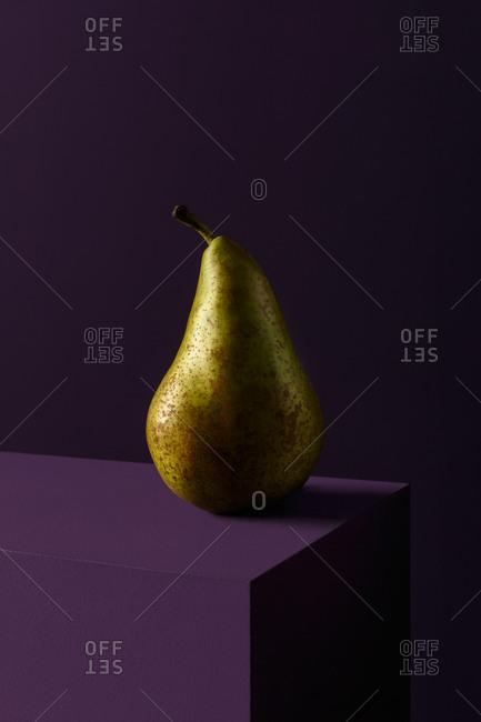 Pear on purple cube