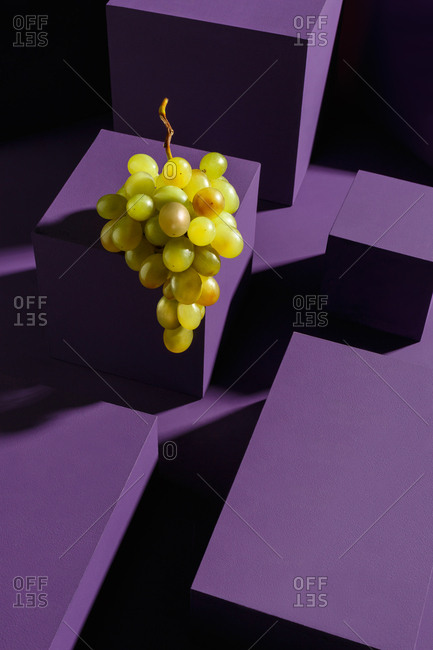 Grapes on installation of purple cubes