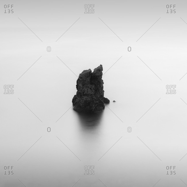 Long exposure of lone rock in the sea at Cape Kogane, Shizuoka Prefecture, Japan