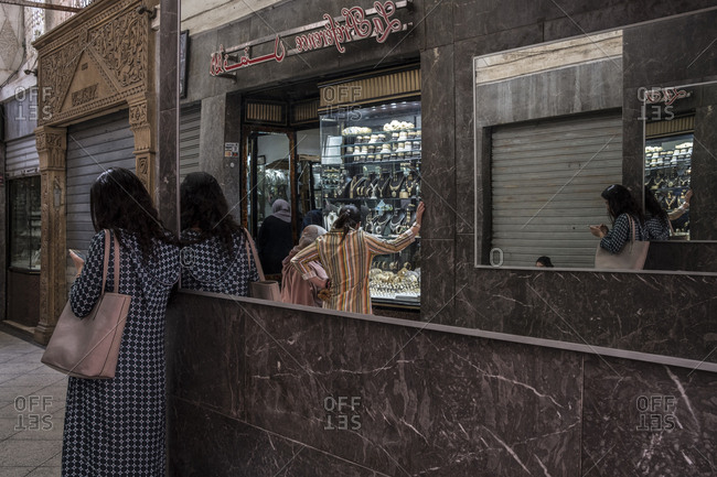 Fes, Morocco - 21 September 2017: Women taking a look at a jewelry store at Fes mellah