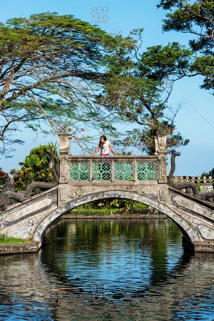 Woman Standing on a Japanese bridge in Bali, Indonesia