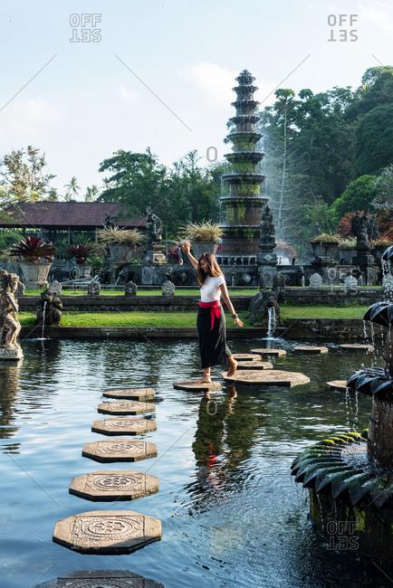 Woman having fun in Water Palace in Bali, Indonesia
