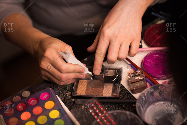 Woman preparing make-up shades for Halloween