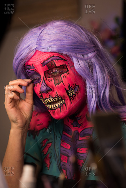 Woman with scary make-up on face for Halloween celebration