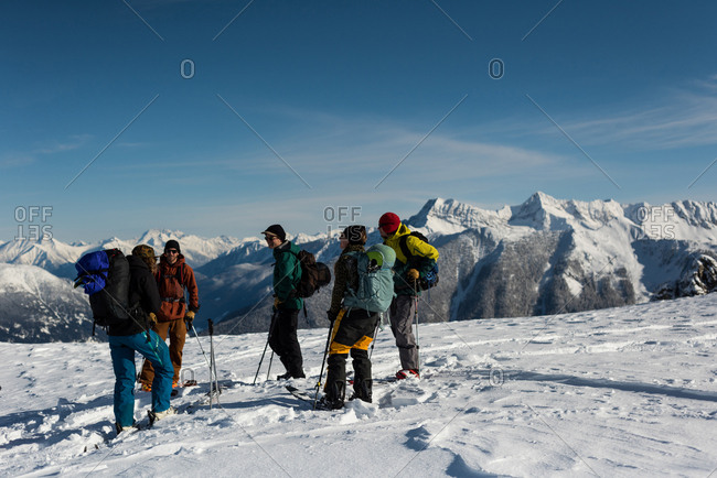 Group of skiers standing on a snowy mountain during winter