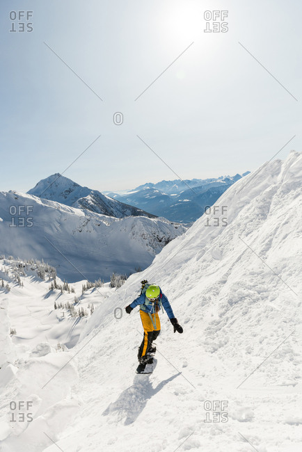 Skier skiing on a snowy mountain during winter