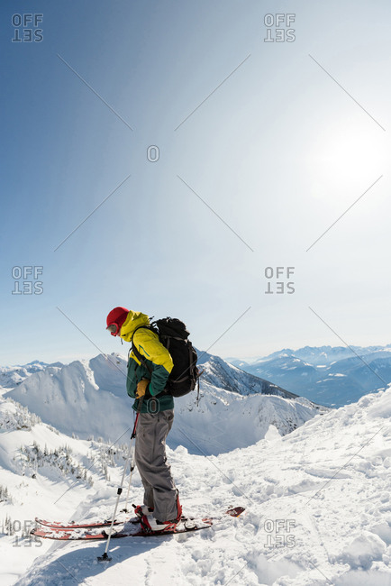 Skier standing on a snowy mountain during winter