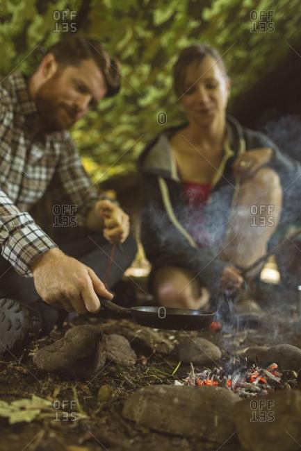 Happy couple preparing food at boot camp
