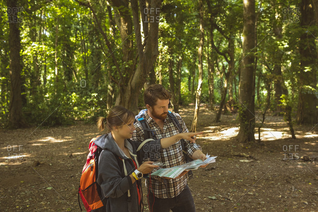 Couple looking at map in boot camp