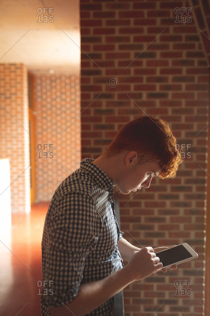 Side view of college student digital tablet in campus