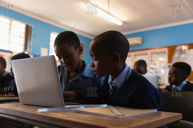 Students using laptop in the classroom at school